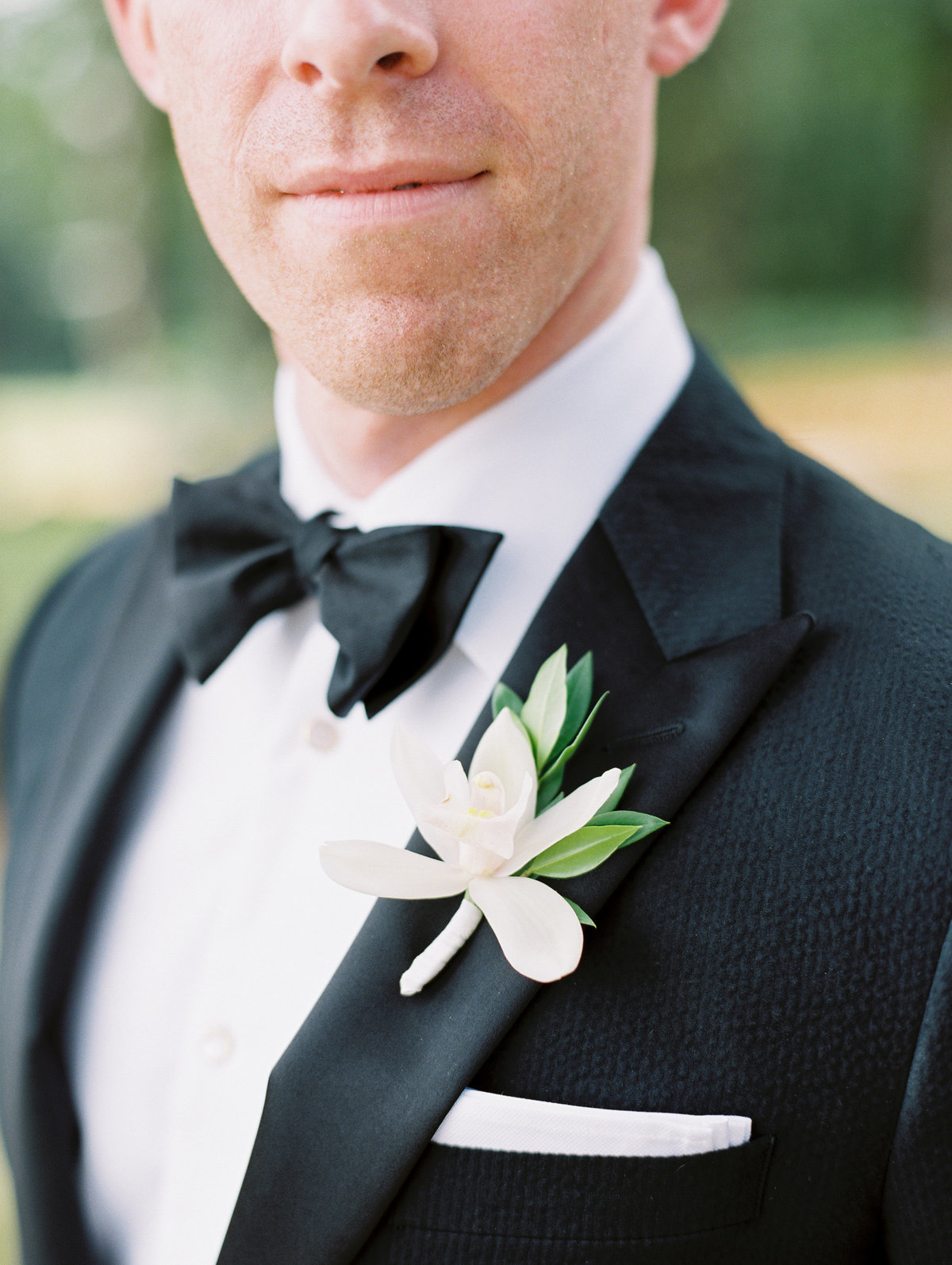 groom's boutonniere made with a lily