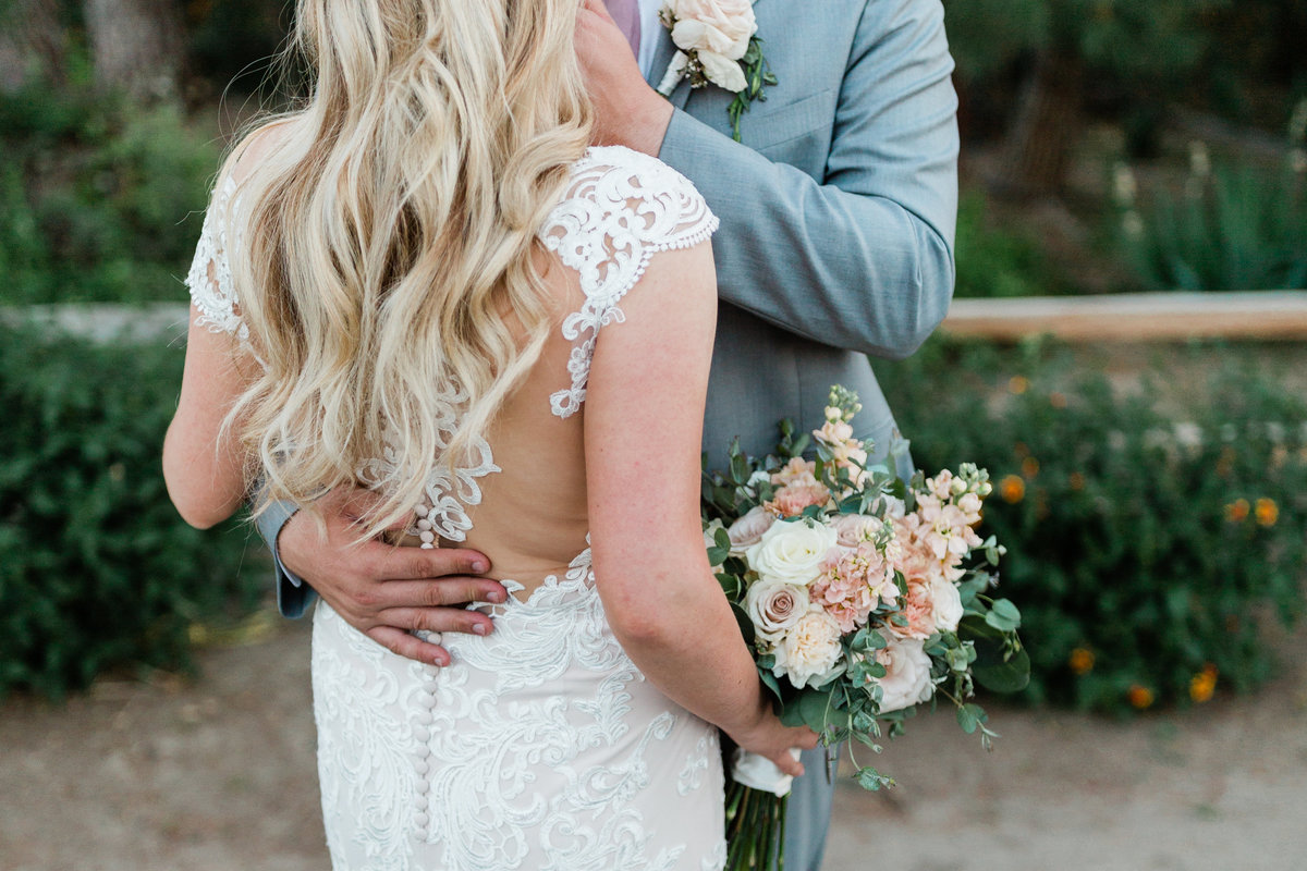 close up photo of a bride and groom embracing