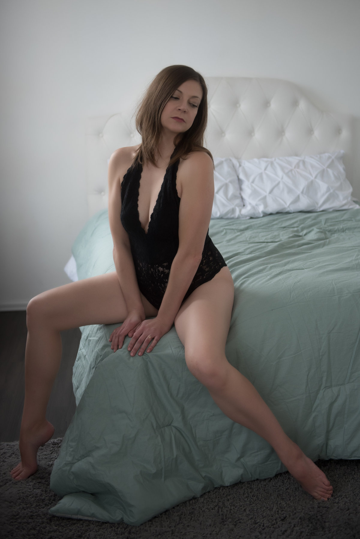 woman at corner of bed