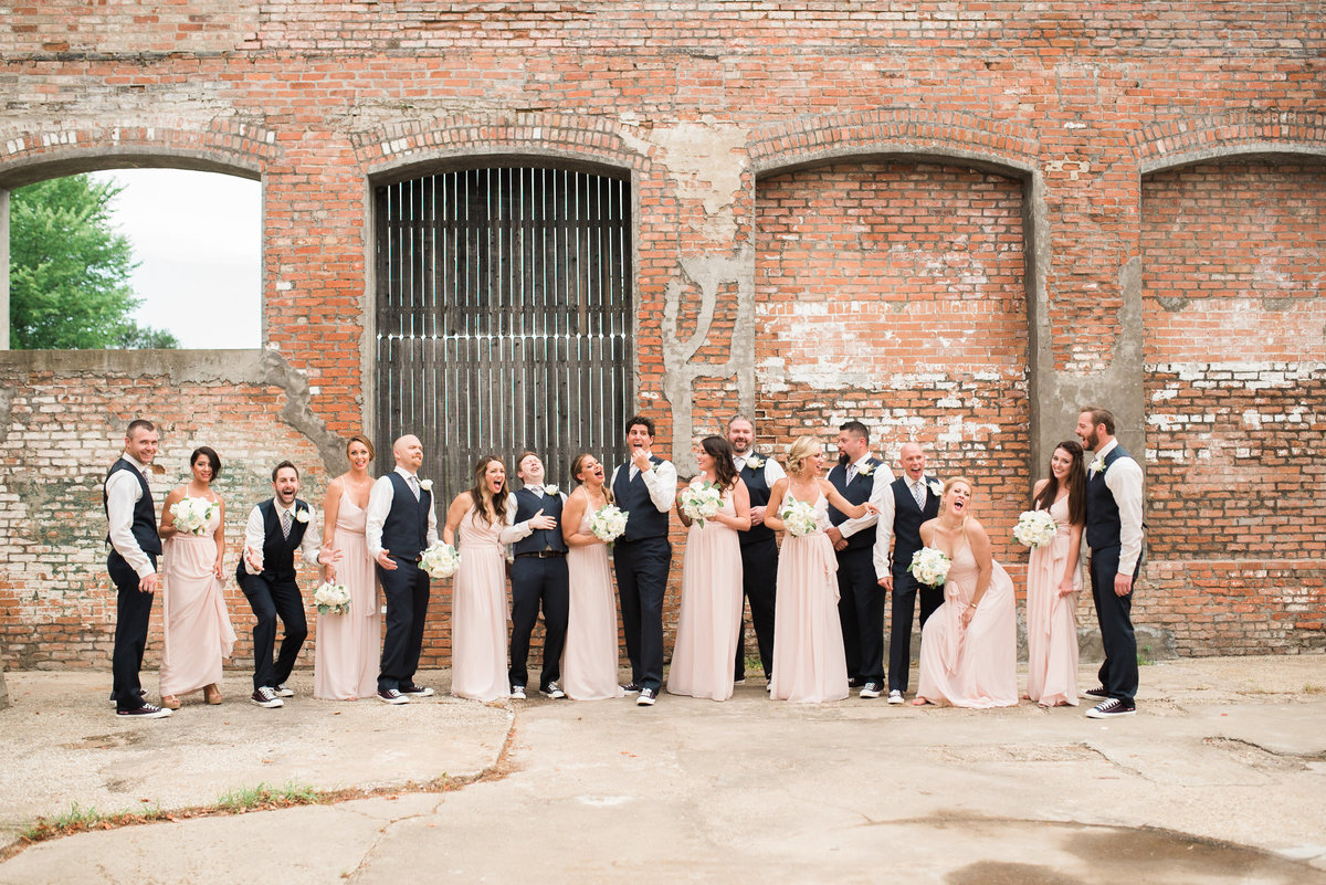 Bridal party posing in rustic venue