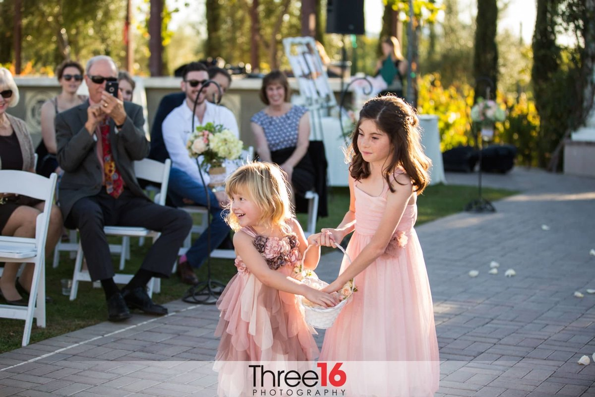 Flower girls dropping pedals as they walk the aisle