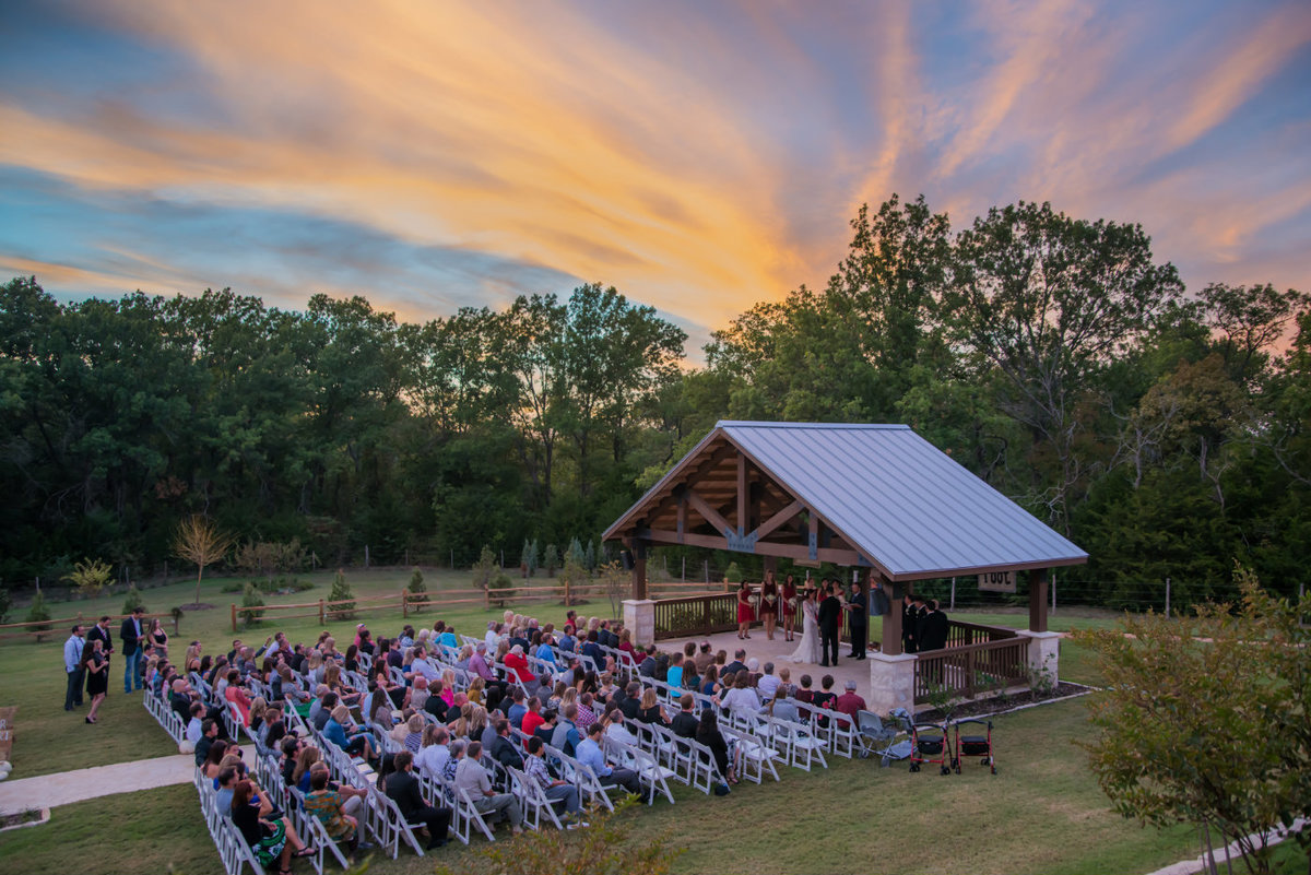 Wedding ceremony at sunset at The Springs McKinney by Brittany Barclay Photography