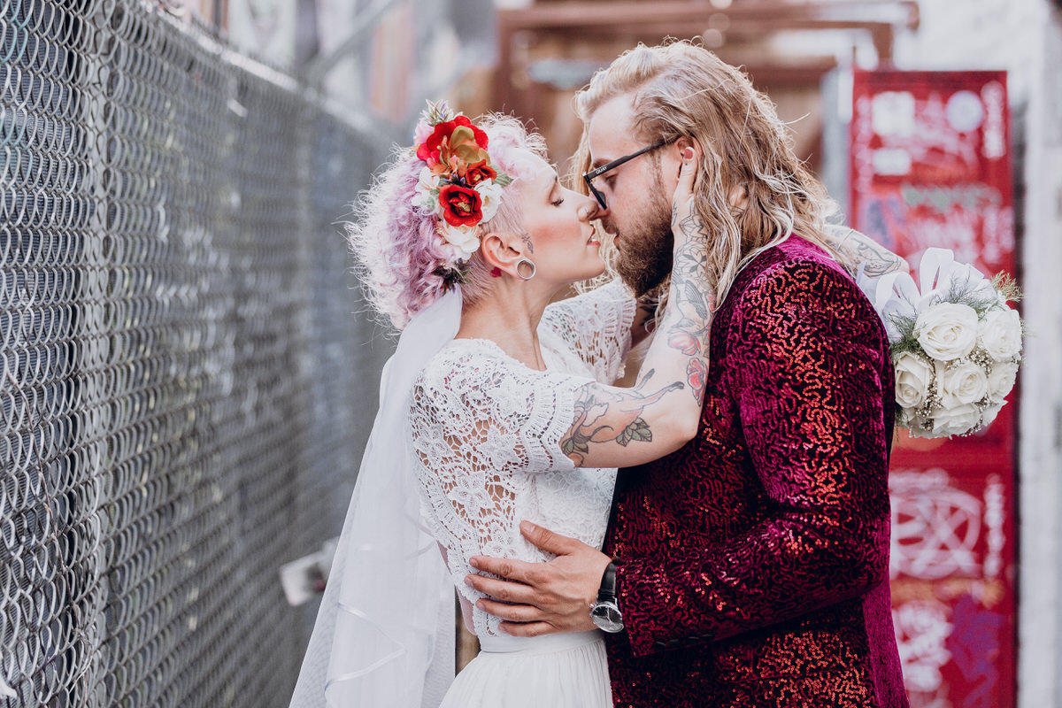 Reno elopement photographers couple embraces in alley