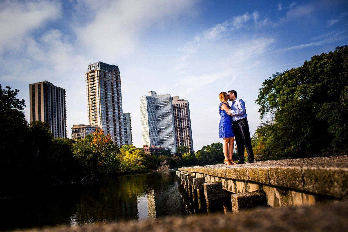 A couple shares a kiss during a Lincoln Park engagement session.