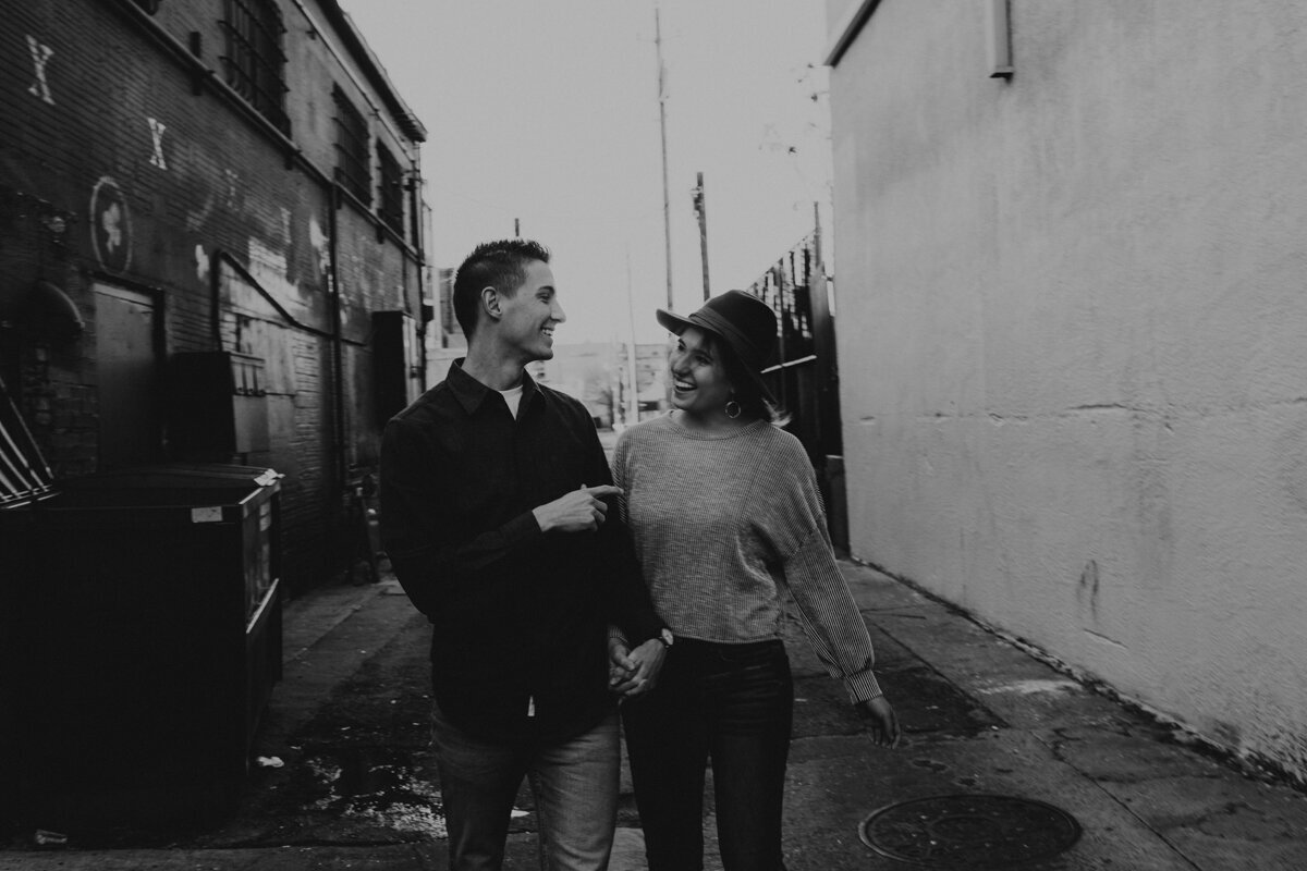 couple walking down an alley downtown Albuquerque