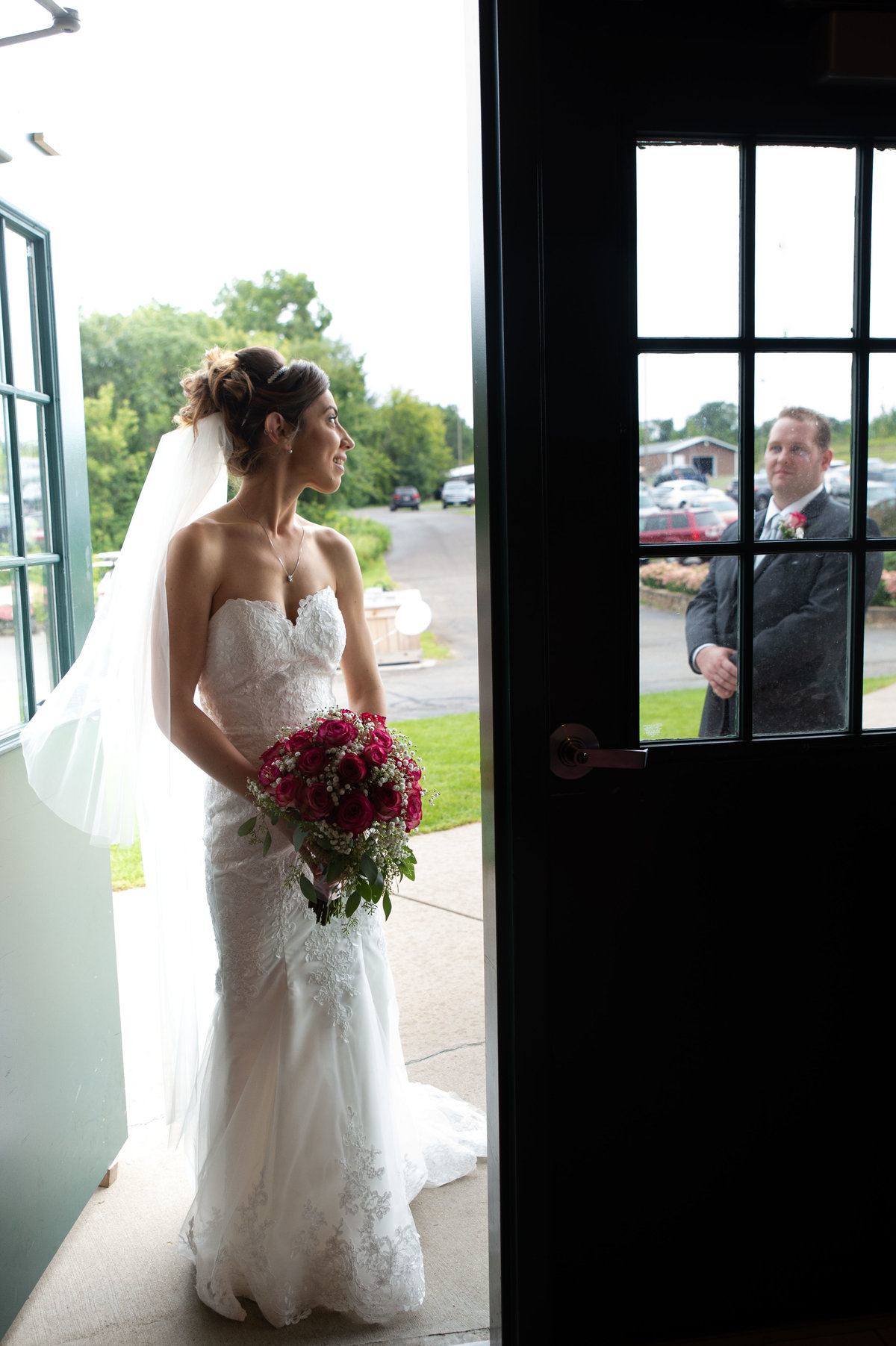 couple exchange look in doorway frame