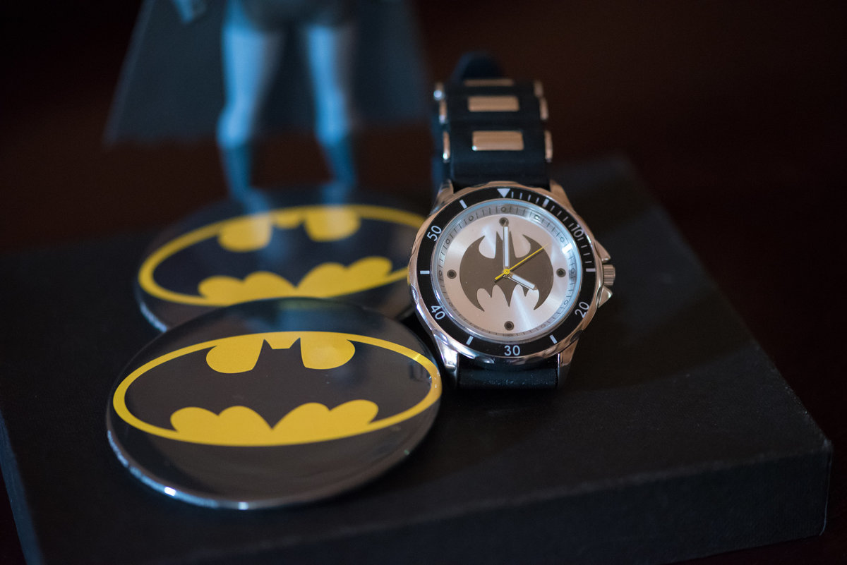The Lodge on Echo Lake, Warrensburg, NY, grooms Batman wristwatch, Batman buttons, Batman molded figurine
