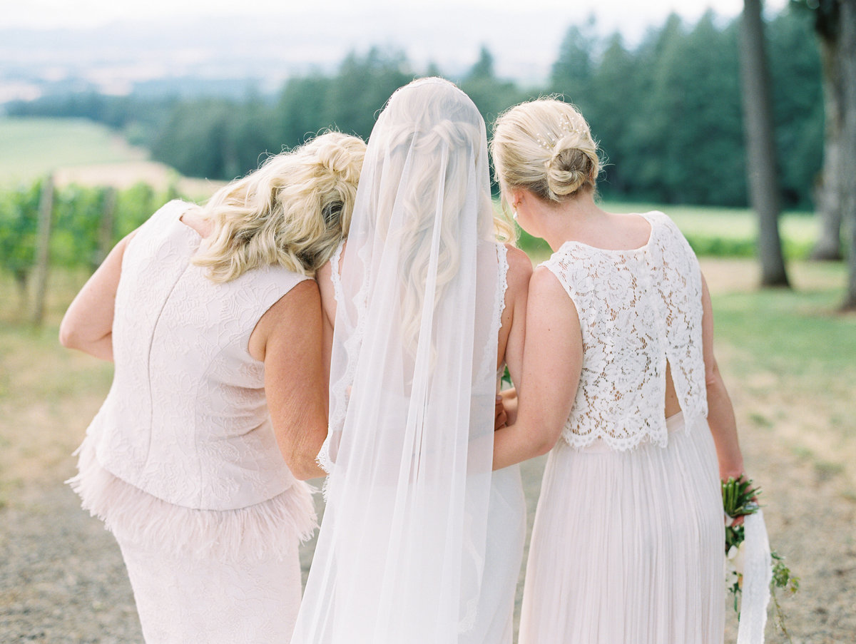 sweet photo of a bride with her mom and sister