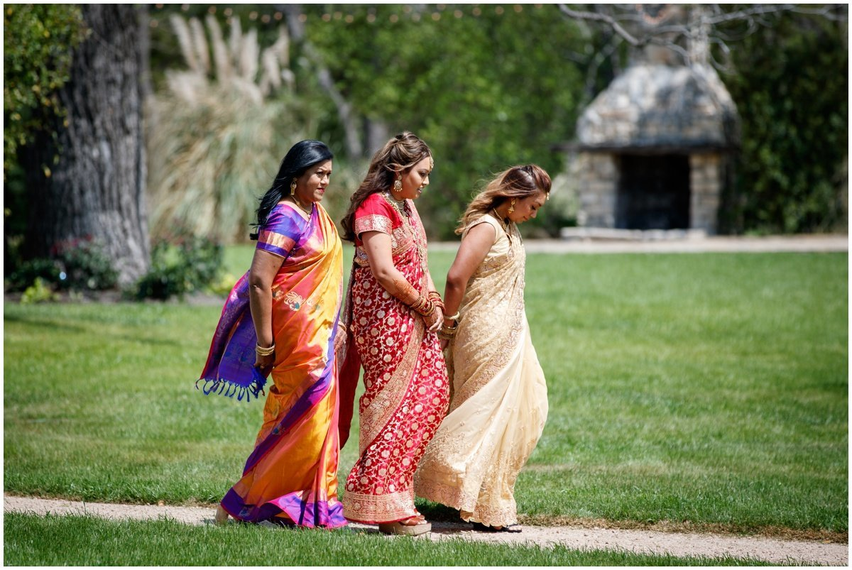Austin wedding photographer pecan springs ranch wedding photographer bride walking to alter Indian wedding