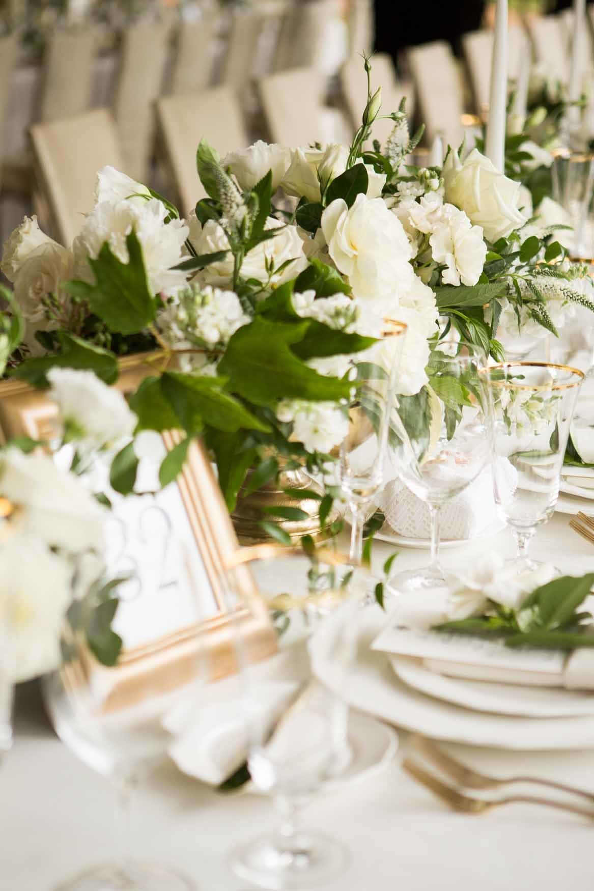 Long white table with low centerpieces
