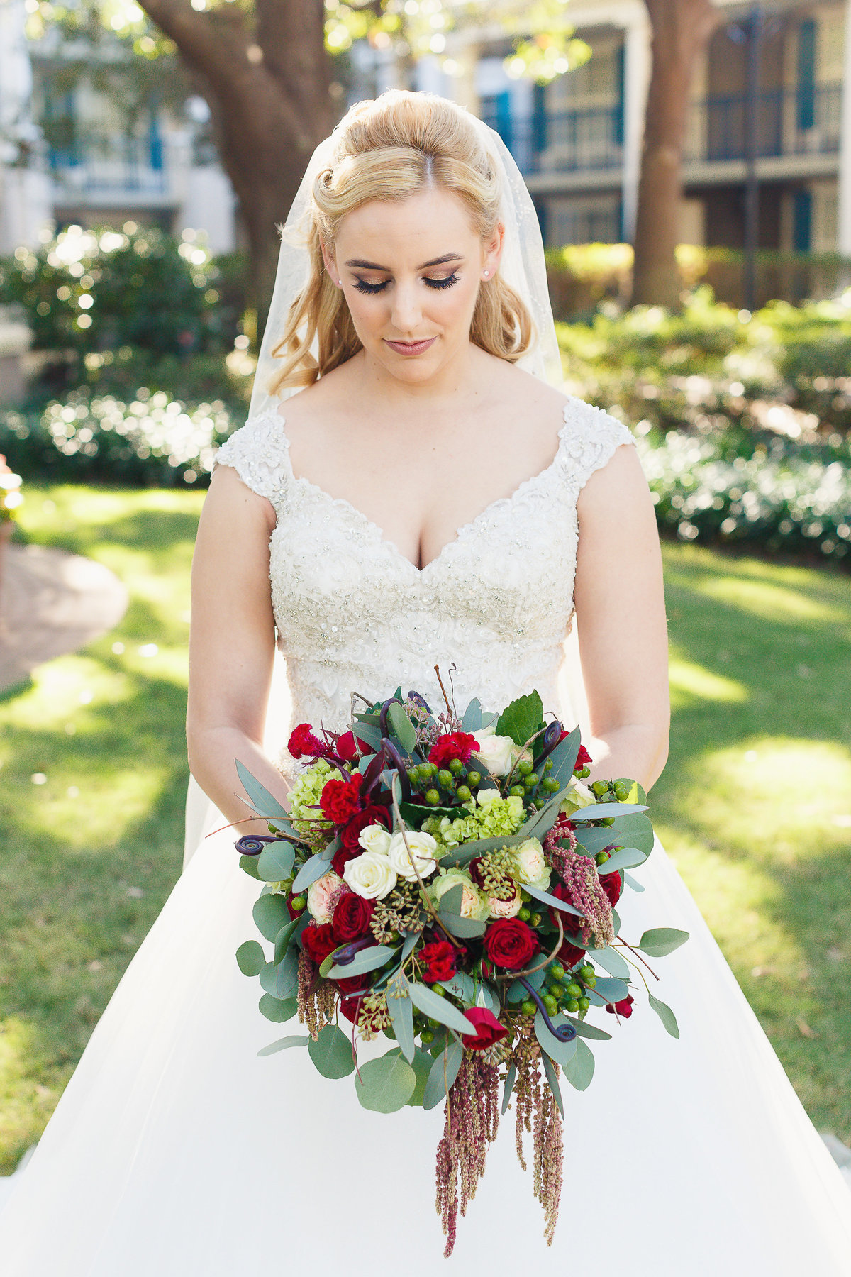 Bride Gazes at Her Bouquet During Her Port Orleans Disney Wedding Photo Shoot