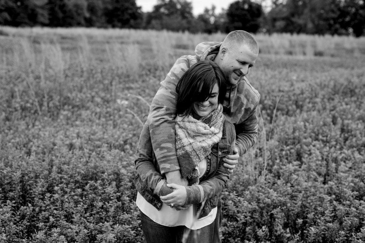 engaged couple in open field at bayone t farm