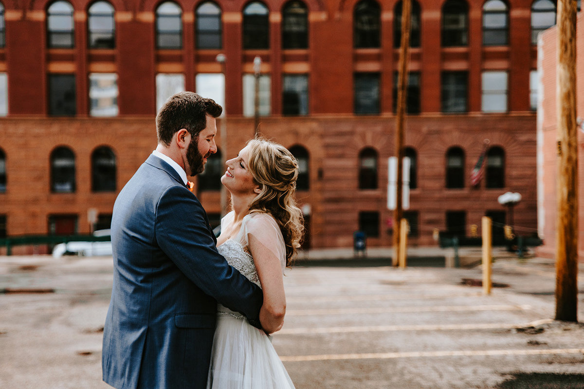 wedding couple near Denver Athletic Club in Denver Colorado