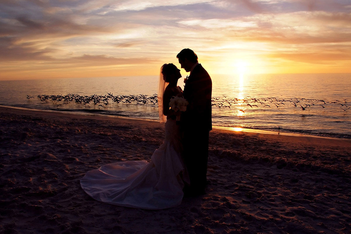 naples beach hotel and golf club sunset wedding