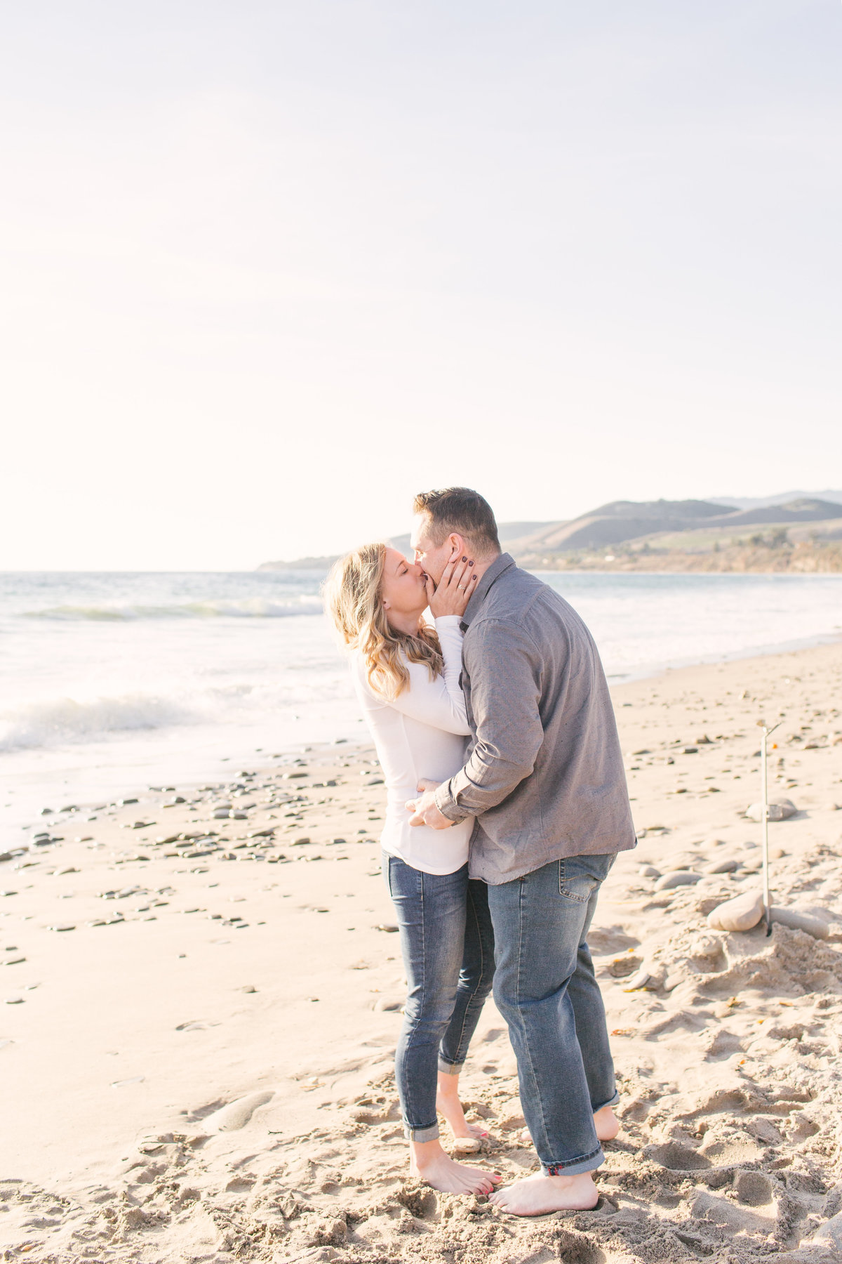 Man kisses woman after proposing at El Capitan State Beach
