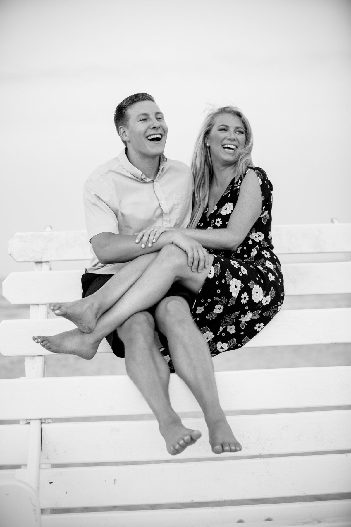 engaged couple on lifeguard stand at manasquan beach