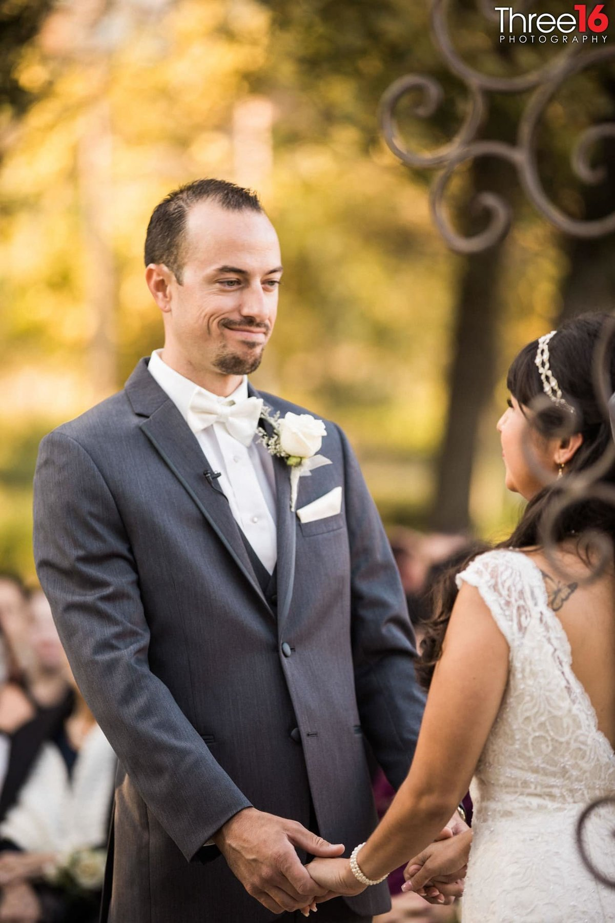 Groom stares at his Bride during the vows
