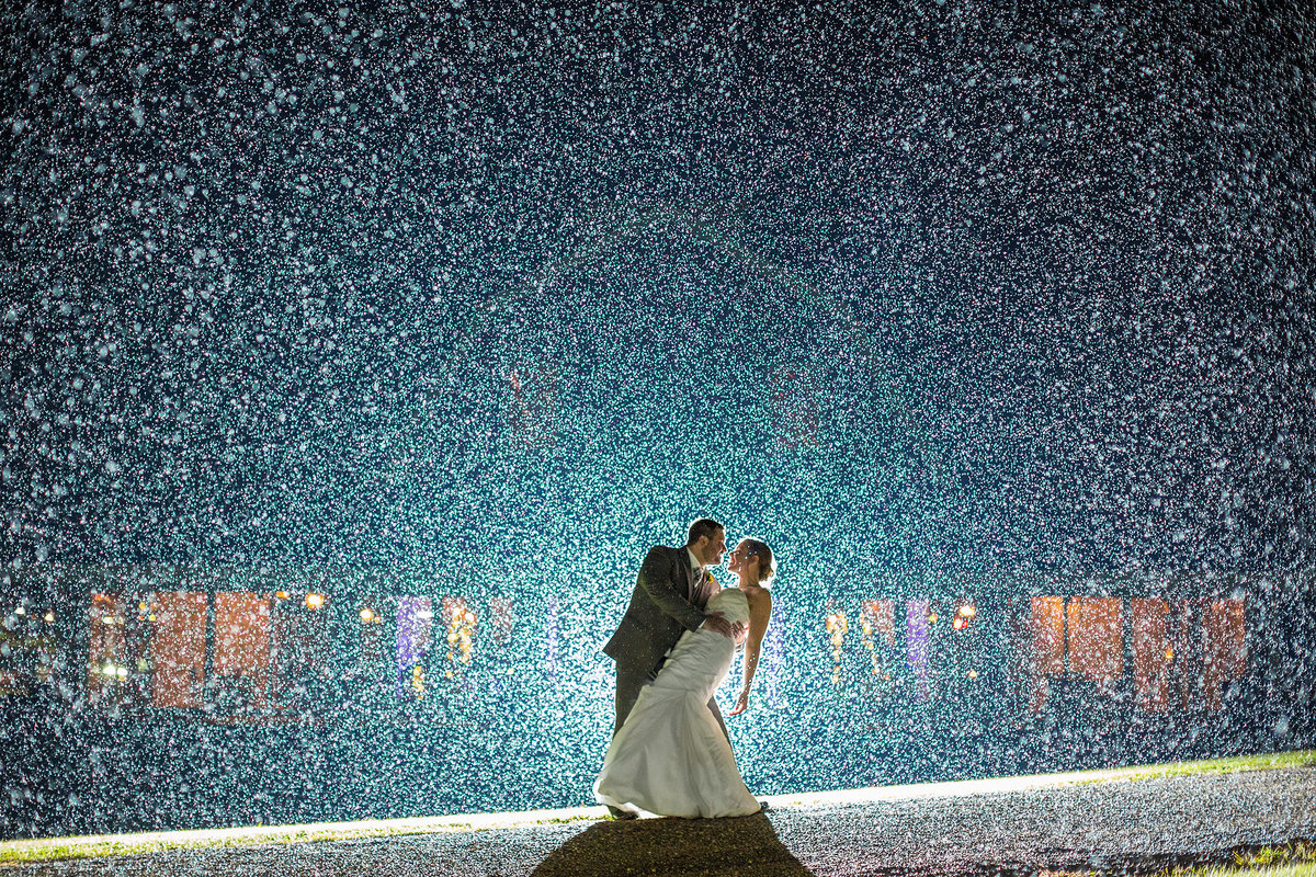 Bride and Groom in rain on wedding day
