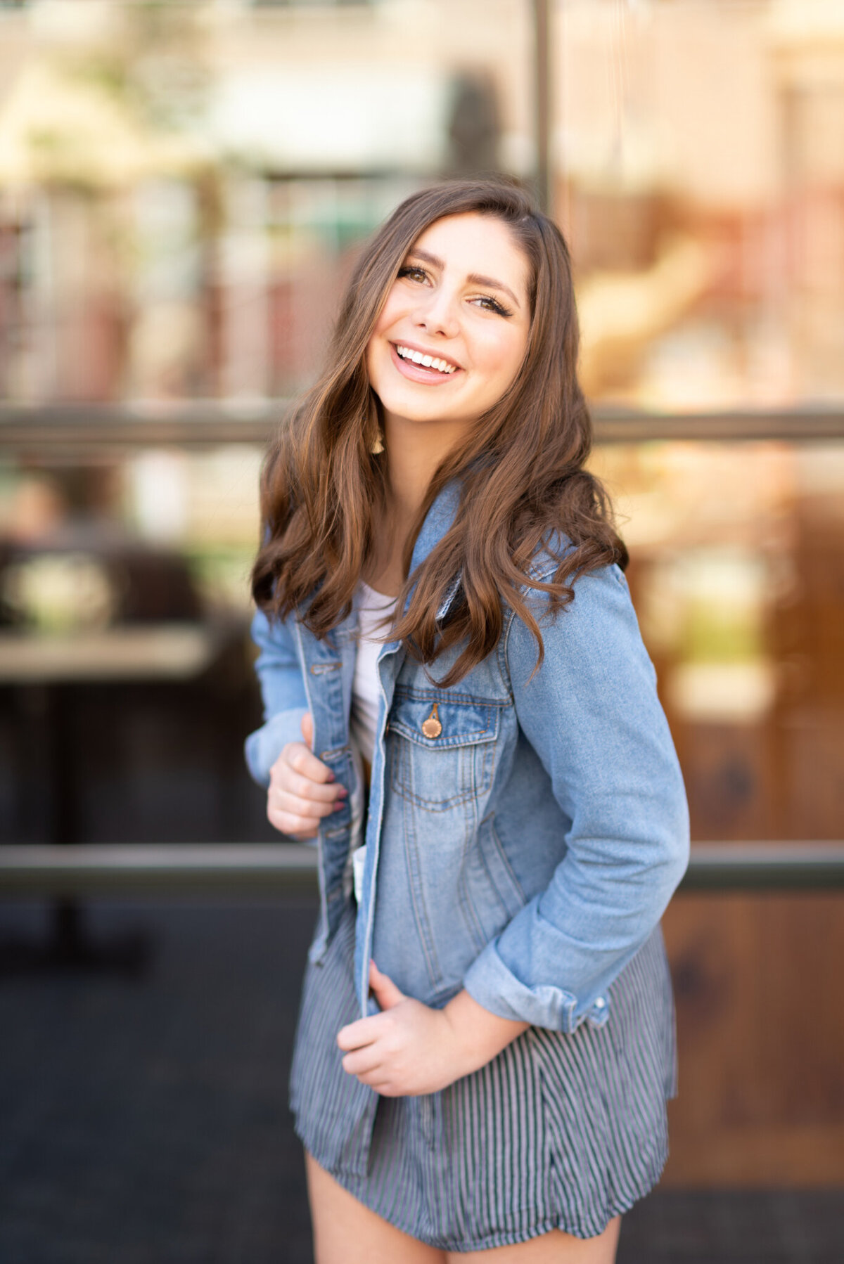 Laughing-woman-in-denim-posing-high-school-senior-picture