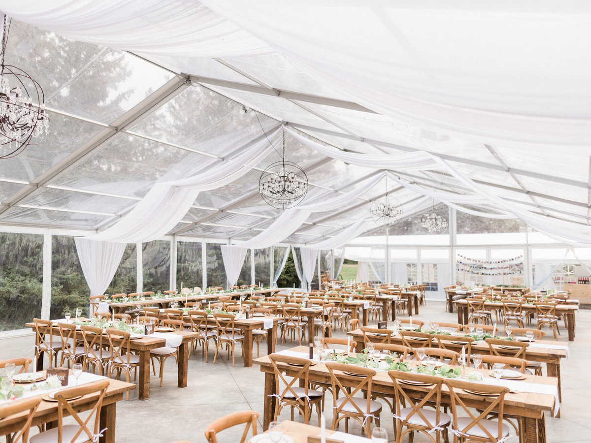 Pine and pond wedding venue with tables and chairs