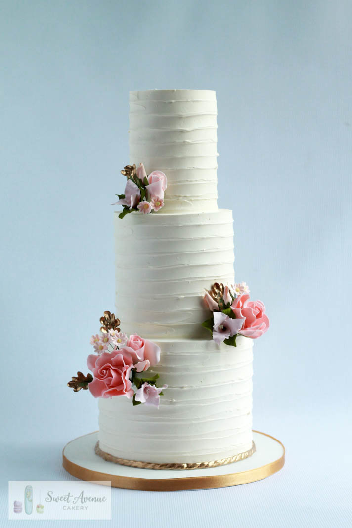 striped buttercream cake with blush pink roses