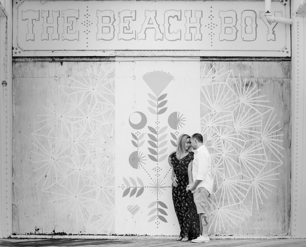 engaged couple by mural in asbury park