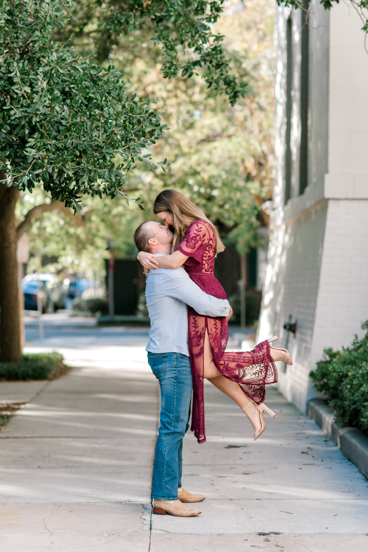 Guy lifts girl during  engagement session