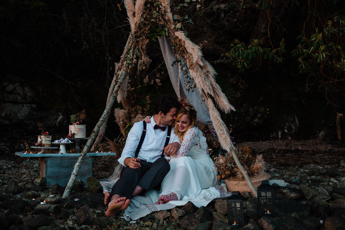 Couple giggling under teepee