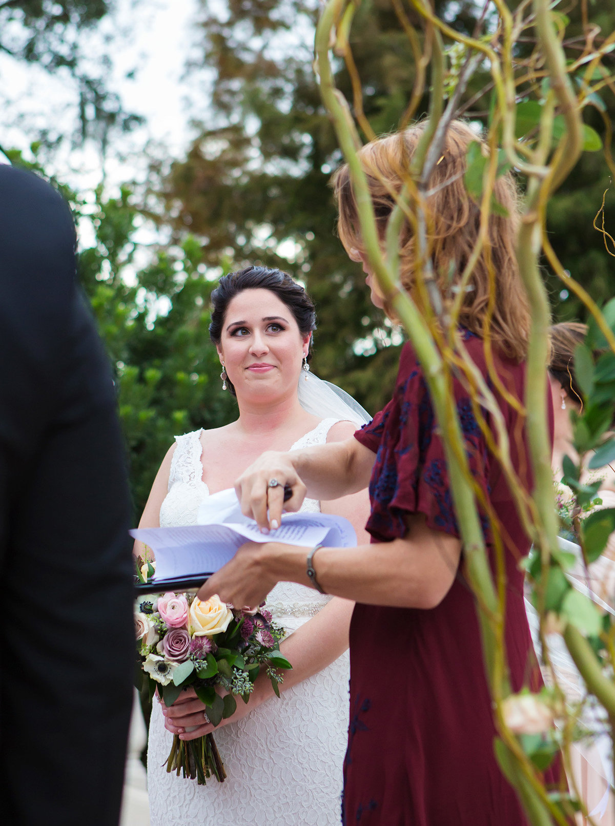 new orleans bride looking at officiant during wedding ceremony in Audubon Park