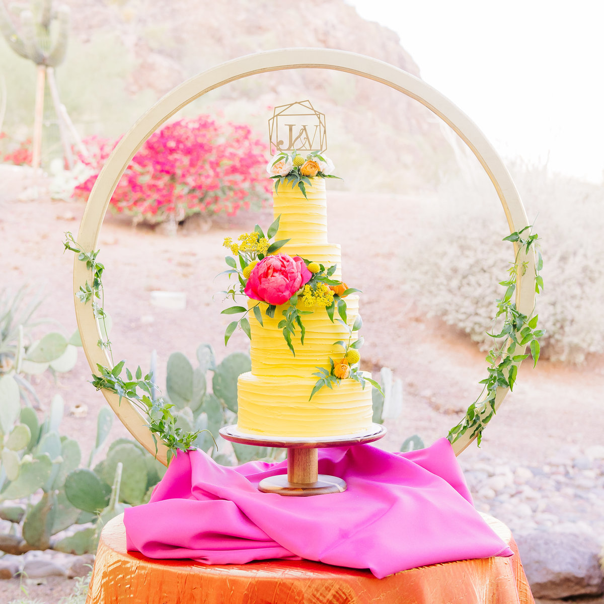 three tier yellow cake with pink flowers planterra conservatory detroit