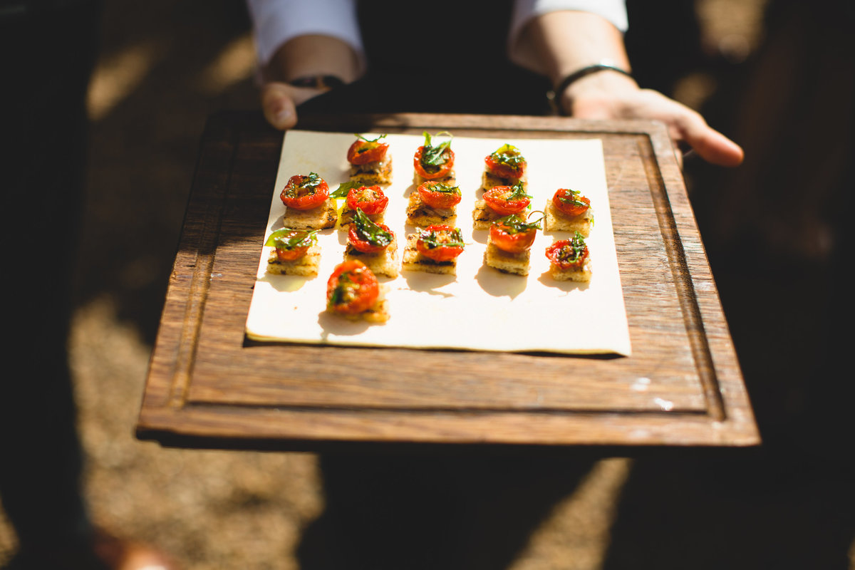 wedding canapes tomato bites on wooden board