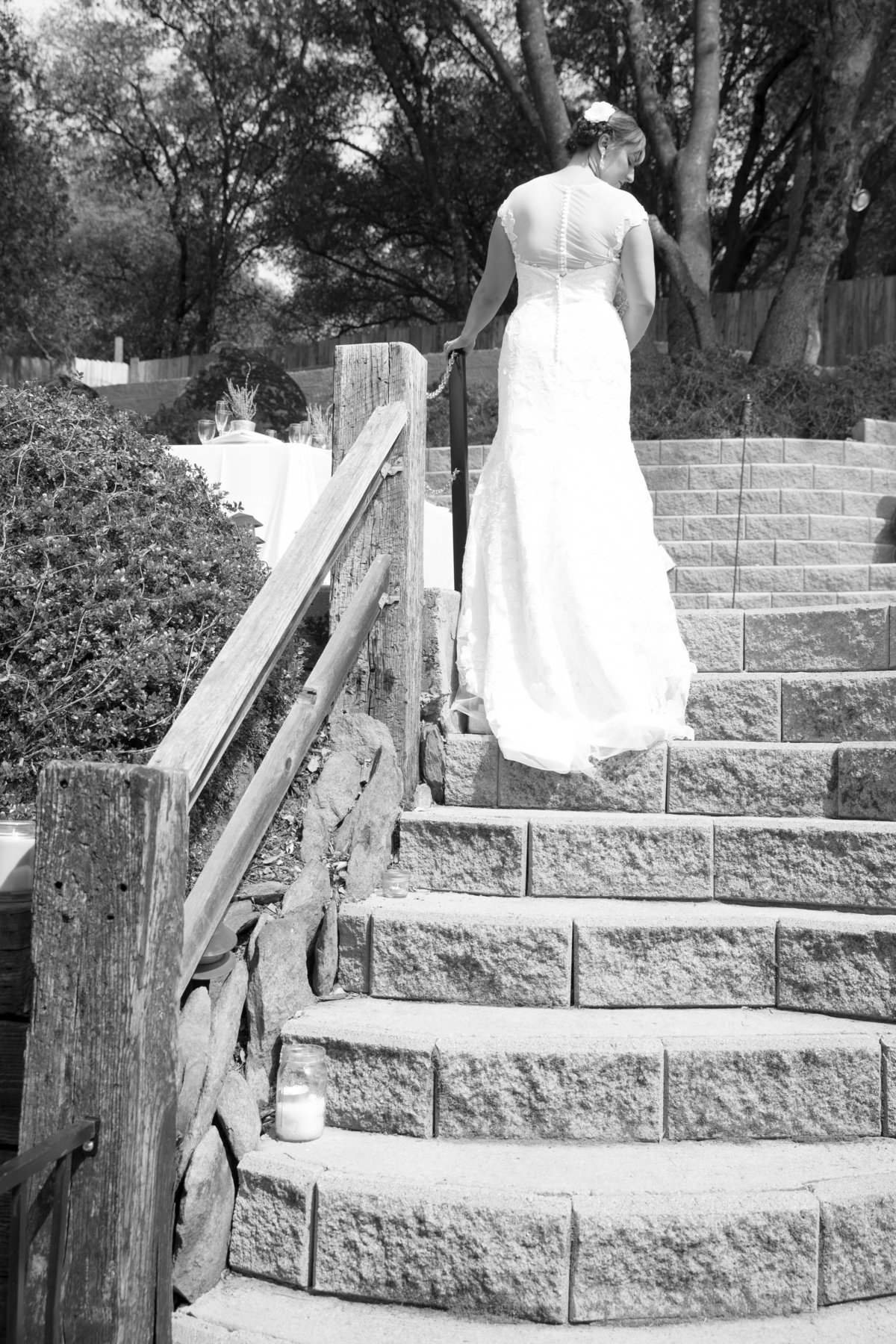 bride poses in her backyard as she reflects her wedding and awaits guests arrival