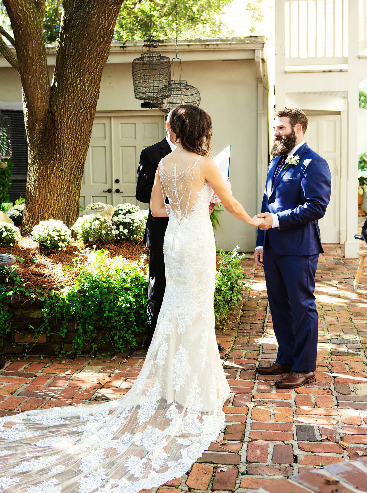 nola destination wedding couple getting married in the courtyard of The Terrell House