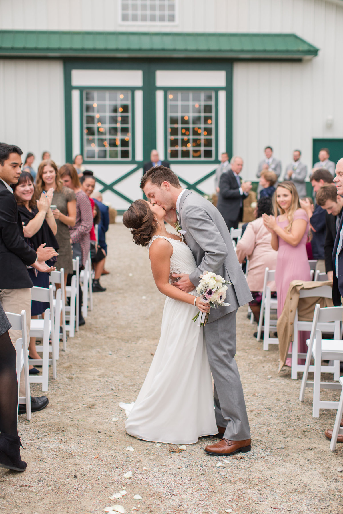 Bride and groom sharing a kiss in front of Culpepper Barn