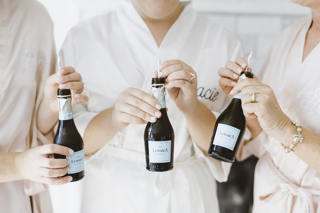 Monica_Relyea_Events_Alicia_King_Photography_Highschool_Sweethearts_Wedding_Grace_and-Doug-Senate-Garage-bubbly-prosecco