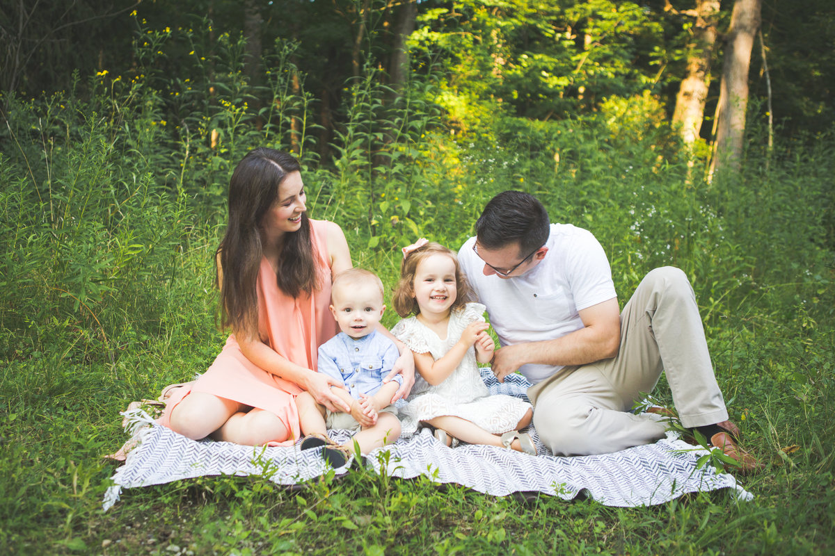 Family sitting and kids being tickled {Brampton Family Photographer}