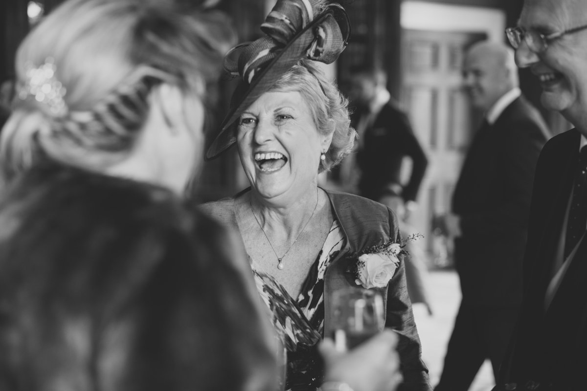 mother of bride laughing at Rudding Park wedding