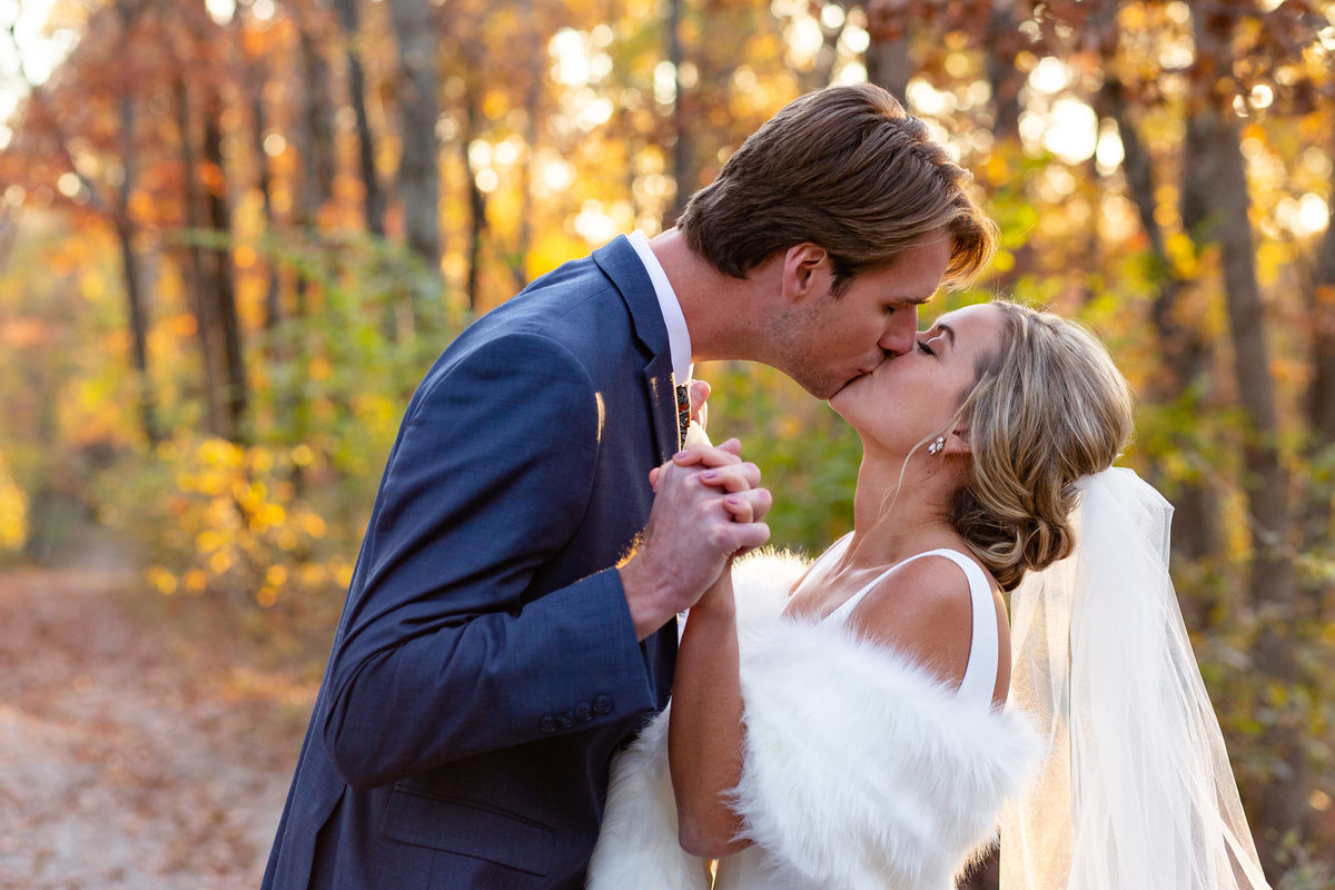 Romantic Sunset Fall Elopement  bride wearing fur wrap and groom in Fall leaves  at Greensfelder County Park in St. Louis  by Amy Britton Photography Photographer in St. Louis