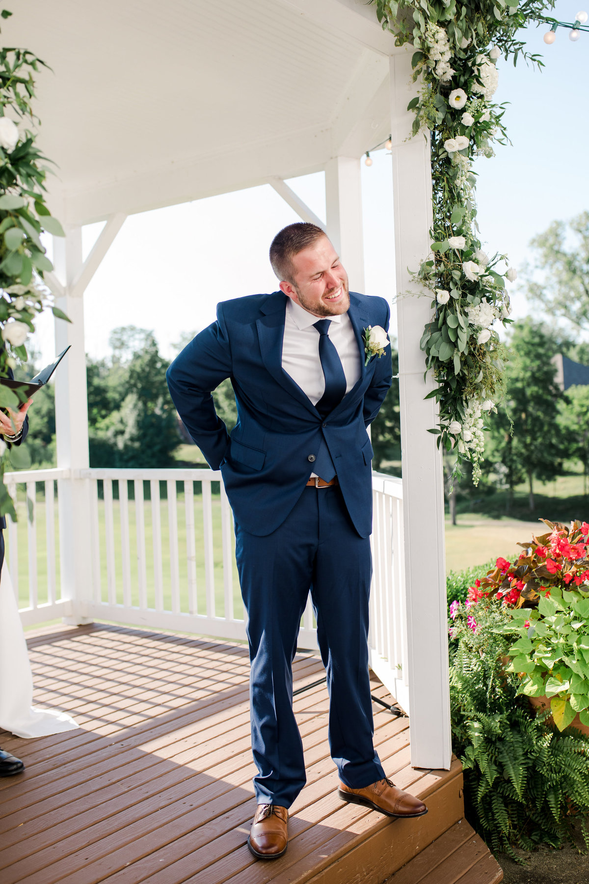 A grooms reaction to the bride walking down the aisle on their wedding day