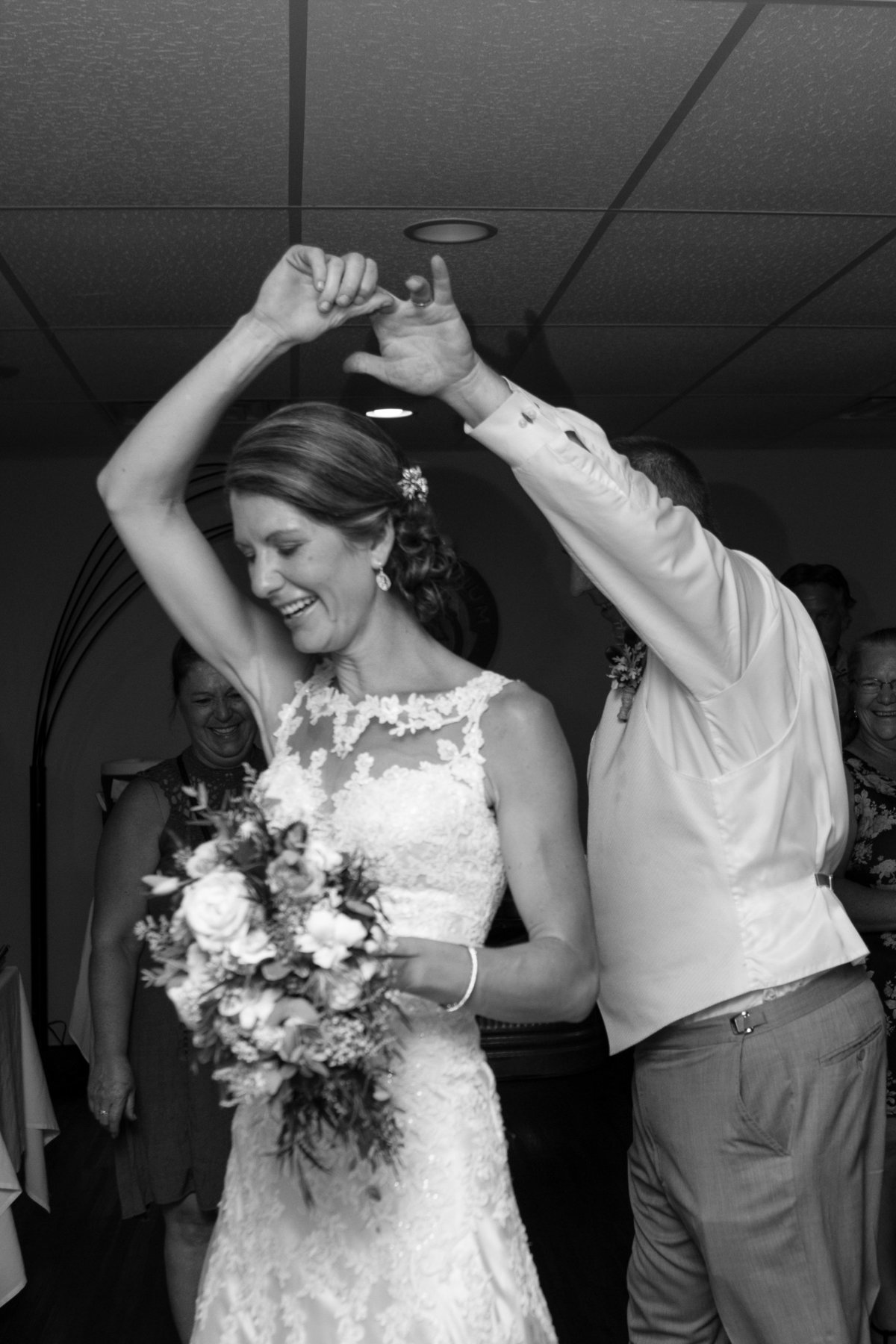 picture showing spin dance with bouquet and front of dress