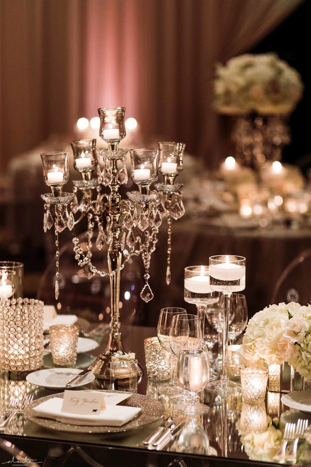 Crystal candelabra on a mirrored table for this winter wedding reception.