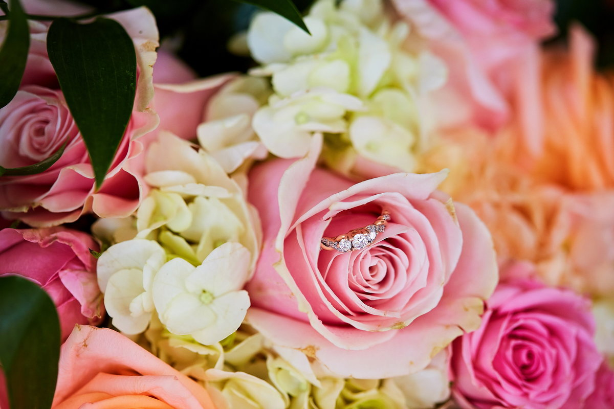 Colorful pink, fuchsia, and peach rose bouquet with wedding band, at Beaufort Inn, SC wedding