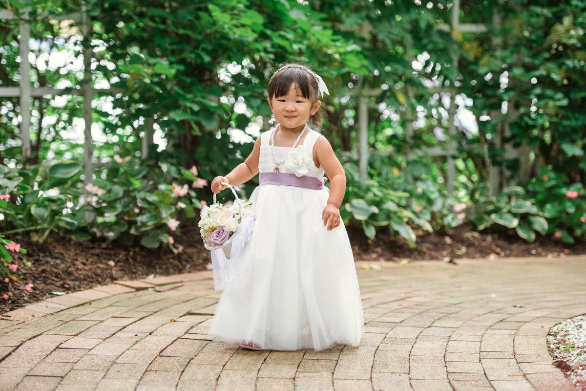 wedding photo of flower girl at The Garden City Hotel