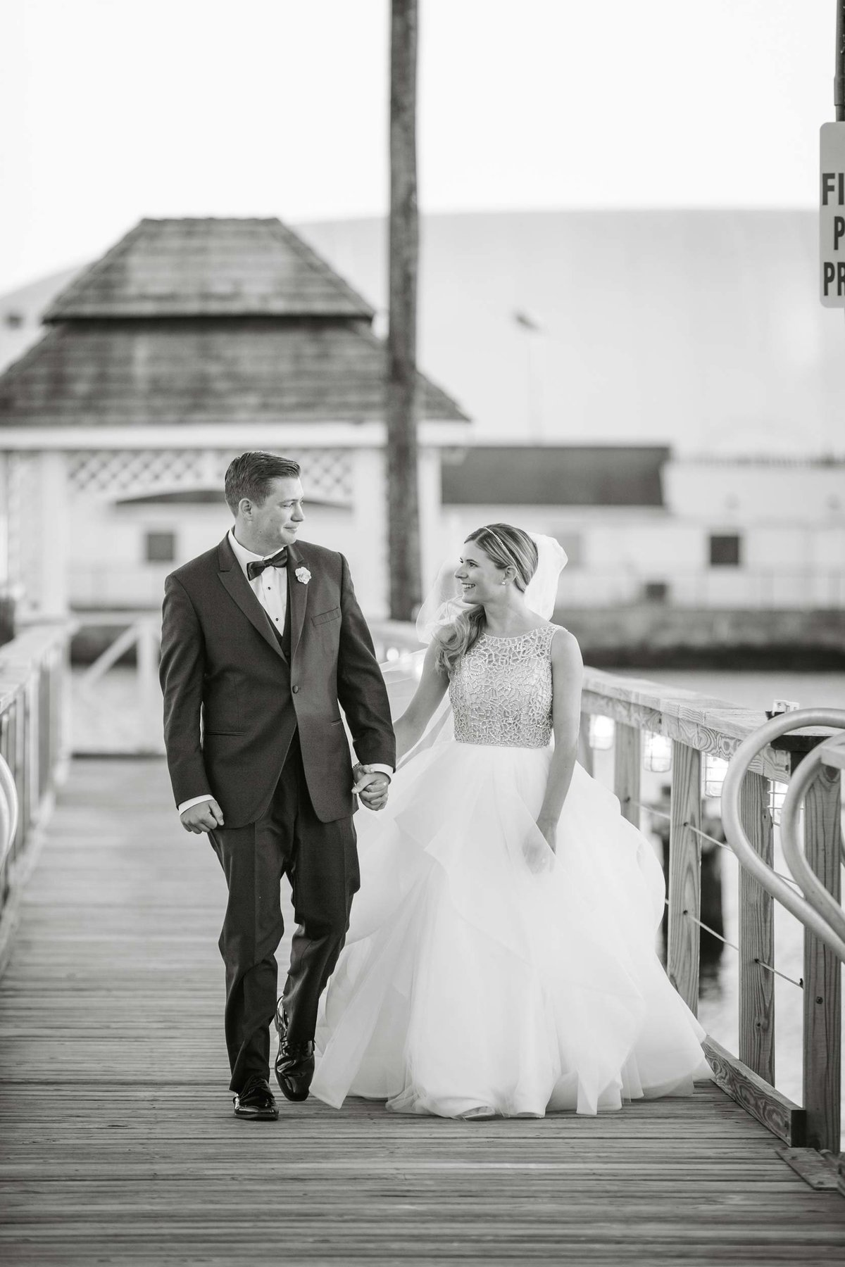 Bride and groom walking the docks of Bridgeview Yacht Club