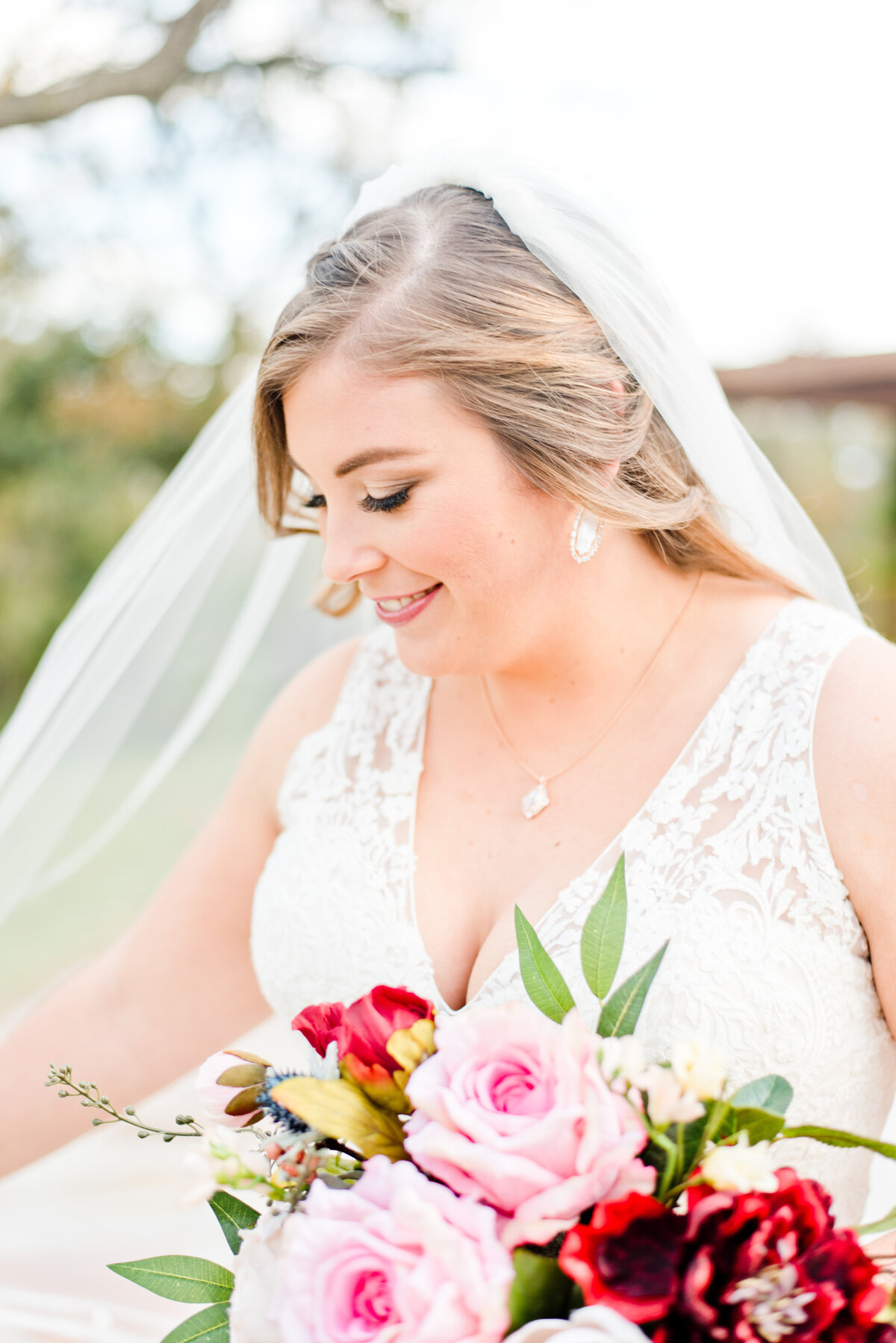 Close up photo of bride with colorful bouquet