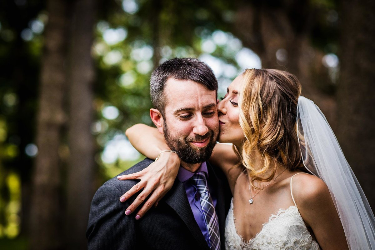 A bride kisses her groom on the cheek during a Katherine Legge Memorial Lodge wedding.
