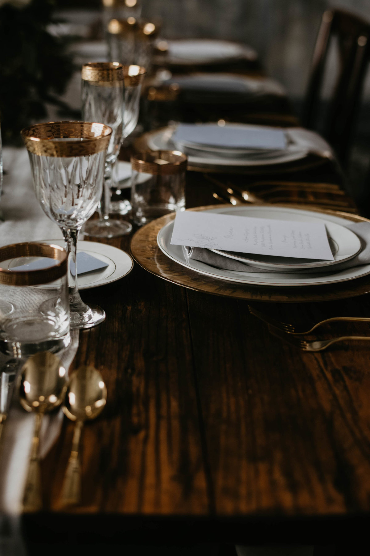 wedding decor on dark wood harvest table