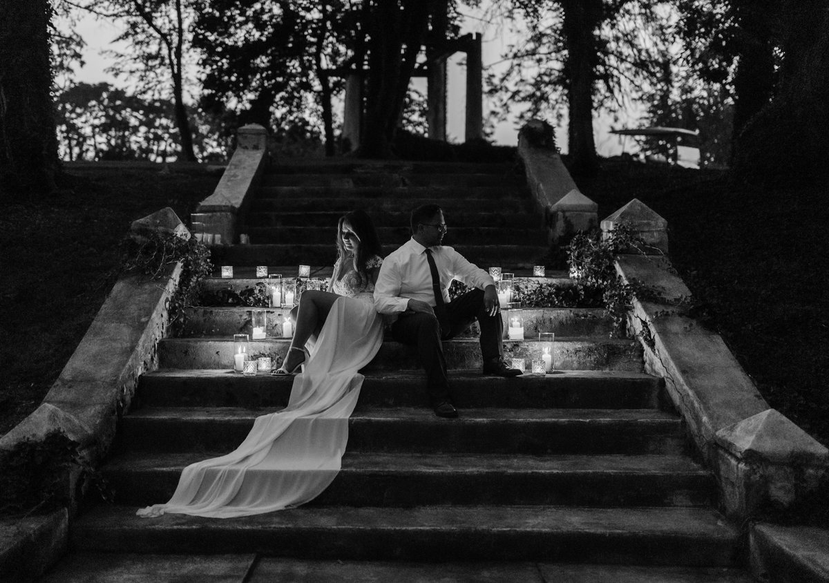 couple on stairs with candles