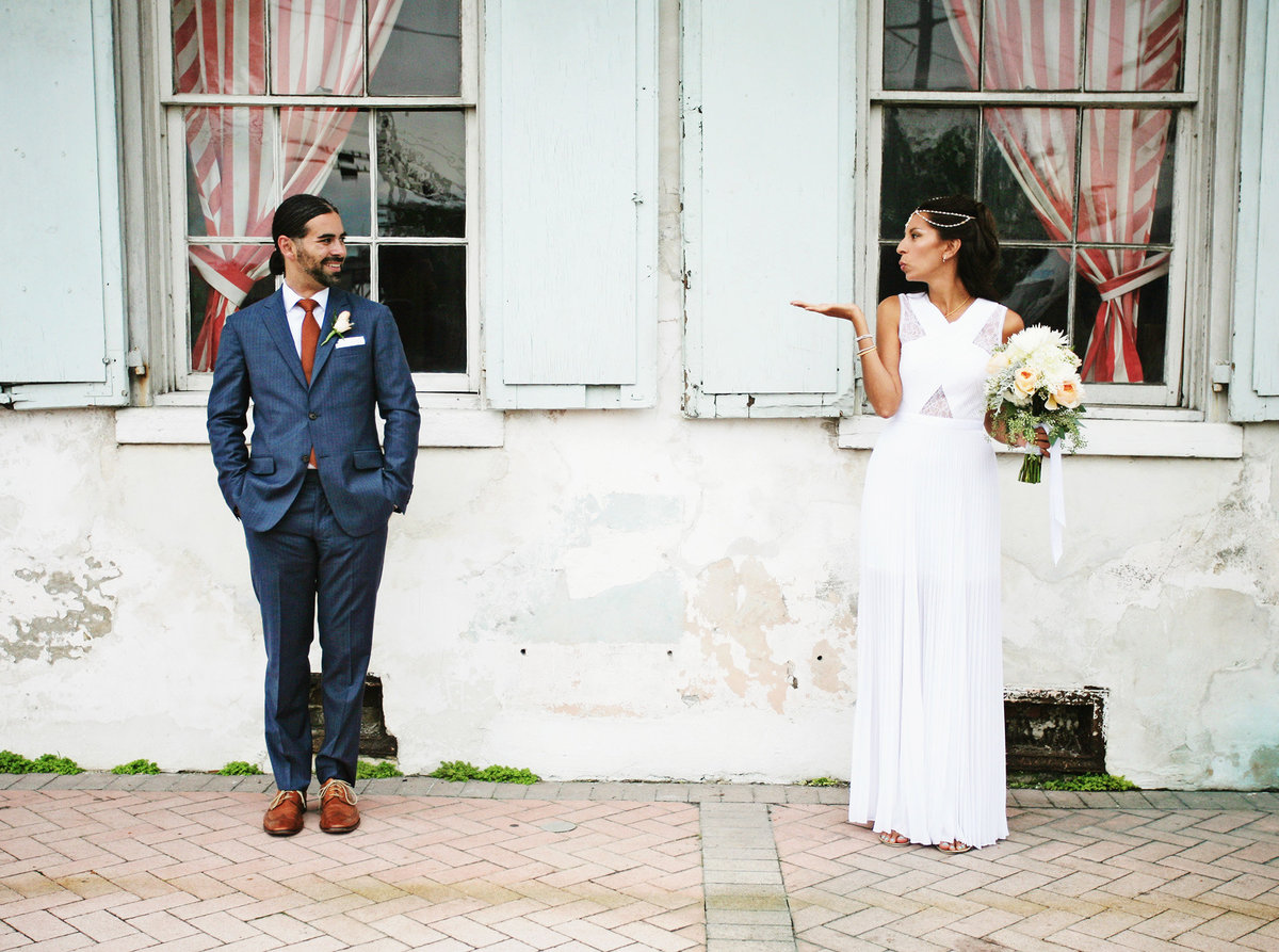 nola destination bride blows a kiss to her groom in front of Race and Religious