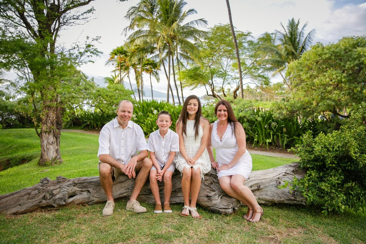 Capture Aloha Photography, Maui Family Portraits sitting  on the wood